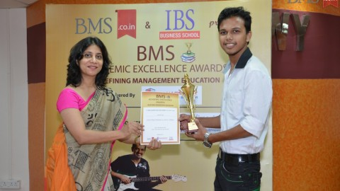 Felicitation of Saurabh Saroj, TYBMS Topper, Universal College of Management, Science and Commerce