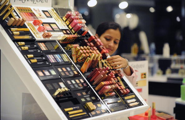 An Shoppers Stop employee arranges cosme