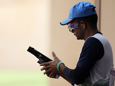 India's Vijay Kumar changes the round in the men's shooting 25m rapid fire pistol qualification round at the London 2012 Olympic Games at the Royal Artillery Barracks