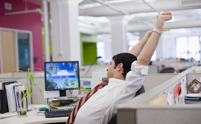 man-stretching-desk