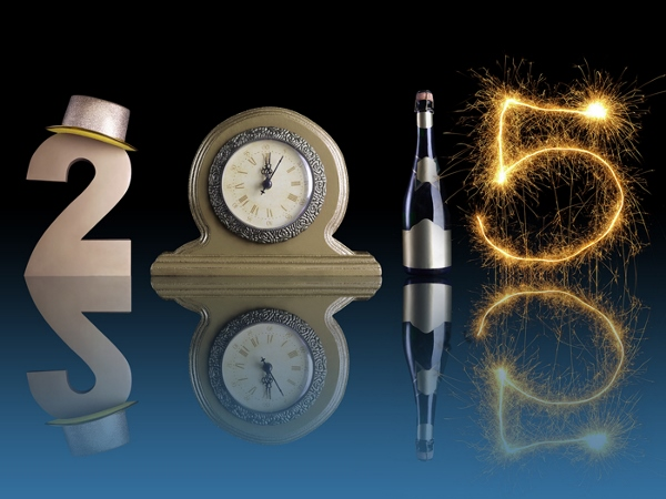 New Year 2015 set up of golden digit two, table clock, bottle of