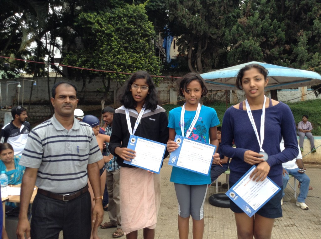 Star swimmer, Saloni Dalal (center) wins the Gold in 50 M Breaststroke